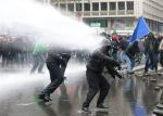 Arcelor Mittal workers from the Liege site are sprayed by water canon during a demonstration outside Prime Minister Elio Di Rupo's office in Brussels
